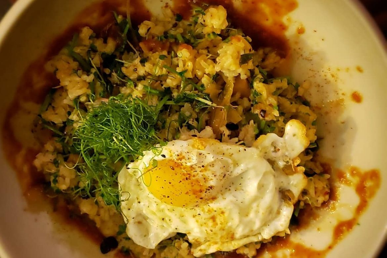 Kimchi fried rice with microgreen medley.